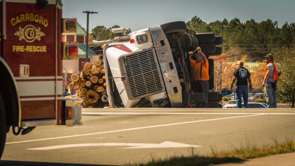 flipped over 18 wheeler tractor trailer wooden load lawyer attorney mcallen mission rgv